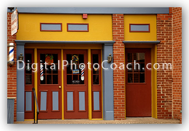orange, red, and blue barber shop exterior